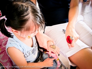 Elmo Hand Art | Singapore Professional Kids Face Painter