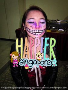 Halloween cheshire cat face painting Happier Singapore