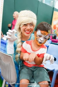 Tiger face painting by Elsa mascot happier Singapore